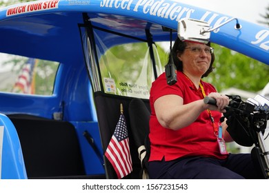 Fond du Lac, Wisconsin / USA - May 27th, 2019: Street Peddlers Tricycle taxi service part take in 2019 Fond du Lac Memorial Parade.