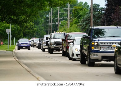 Fond du Lac, Wisconsin / USA - July 16th, 2020: Car and truck parade traveling through fond du lac city streets to show honor to a memorial for 5 year old jayden thomas kaufman.
