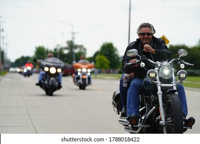 Fond du Lac, Wisconsin / USA - August 1st, 2020: Harley Davidson motorcyclists and bikers groups came out to Fond du Lac to show support in a memorial benefit ride towards Marine Phillip A. Thiessen.