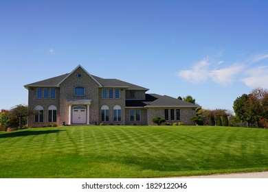 Fond du Lac, Wisconsin /USA -October 6th, 2020: Luxury upscale brick house being sold in the suburbs of Fond du Lac.