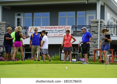 Fond du Lac, Wisconsin / USA - August 9th, 2019: Families from the community of fond du lac enjoyed a summer golf outing at golfing course.