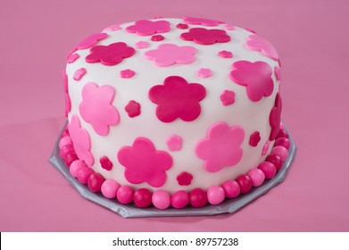 Fondant Cake With Pink Decorations On