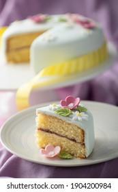 Fondant decorated celebration cake on purple background