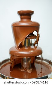 Fondue with chocolate fountain close-up
