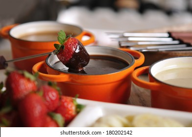 Fondue with strawberry, fruit and hot chocolate
