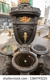 Font de Canaletes with the coat of arms of Barcelona, XIX century. Historic drinking fountain located at the beginning of the Ramblas in downtown, Catalonia, Spain
