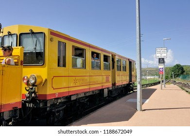 FONT ROMEU, FRANCE - SEPTEMBER 4, 2018: The little yellow train of the Pyrenees waiting for the departure in Font Romeu station