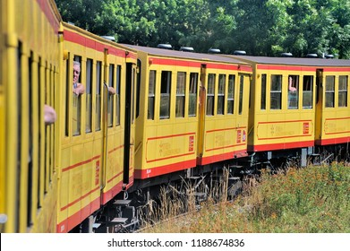 FONT ROMEU, FRANCE - SEPTEMBER 4, 2018: The small yellow trains of the Pyrenees crossing a beautiful mountain landscape