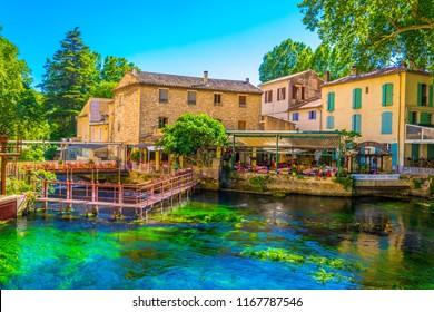 FONTAINE DE VAUCLUSE, FRANCE, JUNE 24, 2017: Riverside promanede at Fontaine de Vaucluse in France