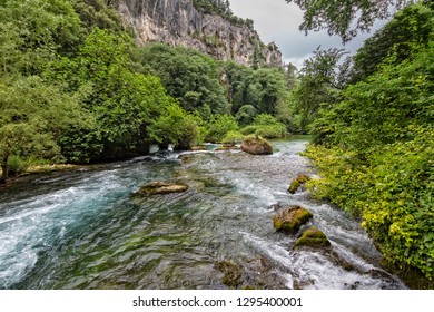 Fontaine de Vaucluse lies at the foot of a 230 m high rock face. It is the largest source in France and a popular natural monument, Provence, Luberon, Vaucluse, France