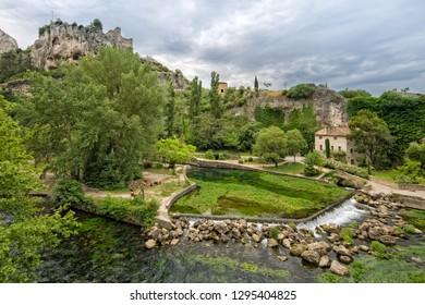 Fontaine de Vaucluse, Provence, Luberon, Vaucluse/France - 05 31 2017: The river Sorgue and ruins of the Château des Evêques