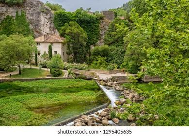 Fontaine de Vaucluse, Provence, Luberon, Vaucluse/France - 05 31 2017: Sorgue River and François Petrarque Library-Museum