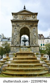 The Fontaine des Innocents in Paris in cloudy autumn day.