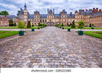FONTAINEBLEAU, FRANCE - JUNE 31: Chateau de Fontainebleau on a cloudy day, residence of Napoleon I, Paris, France, June 31, 2013, Paris, France.