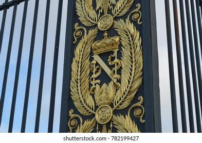 FONTAINEBLEAU, PARIS/FRANCE - DECEMBER 2017: Golden Armorial bearings of Napoleon Bonaparte, gates in front of FONTAINEBLEAU Palace in FONTAINEBLEAU, Paris, FRANCE.