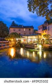 FONTAINE-DE-VAUCLUSE, FRANCE - JUNE 28, 2017: Idyllic evening in famous Fontaine-de-Vaucluse village, Vaucluse department, Provence, France