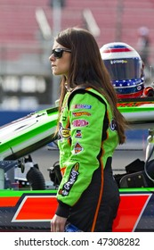 Fontana, CA - FEB 20, 2010:  Godaddy girl, Danica Patrick, gets ready to start the Stater Bros 300 race at the Auto Club Speedway in Fontana, CA on Feb 20, 2010