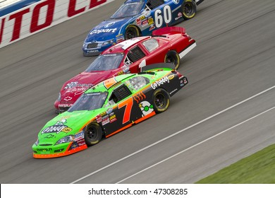 Fontana, CA - FEB 20, 2010:  Danica Patrick makes it three wide with James Buescher, and Carl Edwards during the Stater Bros 300 race at the Auto Club Speedway in Fontana ,CA on Feb 20, 2010