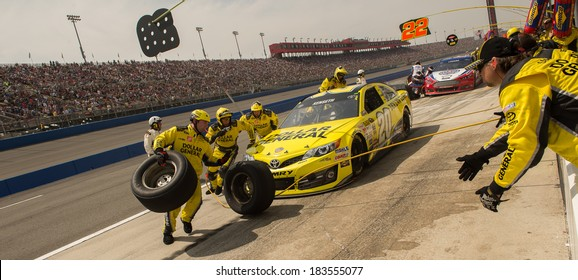 FONTANA, CA - MAR 23: Pit stop and tire changeing for Matt Kenseth at the  Nascar Sprint Cup Auto Club 400 race at Auto Club Speedway in Fontana, CA on March 23, 2014