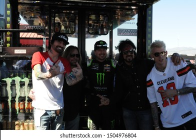 FONTANA, CALIFORNIA - MARCH 17: Tommy Lee, Vince Neil, Nikki Sixx and Machine Gun Kelly take a photo with Kurt Busch at the Monster Energy NASCAR Cup Series race on March 17, 2019 in Fontana, CA.