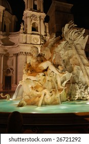 Fontana dei Quattro Fiumi (Fountain of the Four Rivers) at Night, in front of the Chiesa di Agnese in Agone, Piazza Navona, Rome, Italy