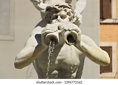 Fontana del Moro in Piazza Navona in Rome. Rome Italy. 05/02/2019. Detail of a sculpture in white marble with a mouth from which water comes out.
