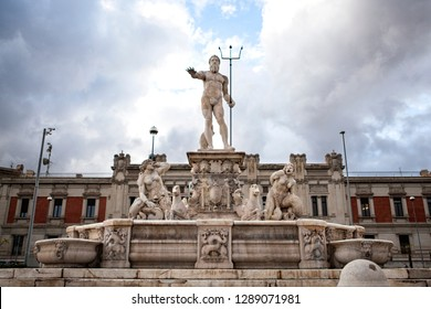 """""""Fontana del Nettuno"""" - Fountain and Statue of Neptune (Poseidon - The ancient statue of god of sea and ocean in Greek Mythology) with cloudy blue sky. Messina, Sicily, Italy. Marble."""