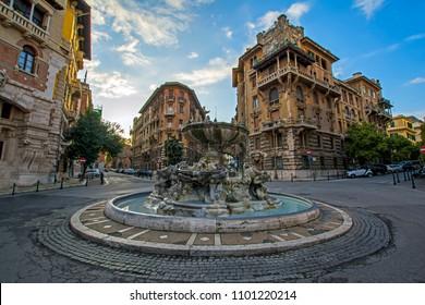 Fontana delle Rane in Piazza Mincio, Quartiere Copped, Rome, Italy. Palazzo del Ragno on the left, Banca Carim - Sede Di Roma on the right