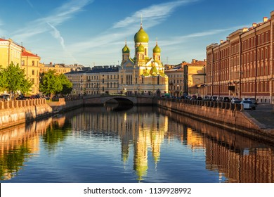 Fontanka river embankment in the early morning with St. Isidore Church, St. Petersburg, Russia. Fontanka is the name of the river. Mogilevsky is the name of the bridge in St. Petersburg