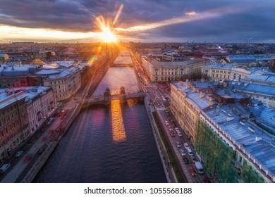 Fontanka river Lomonosov bridge at sunset