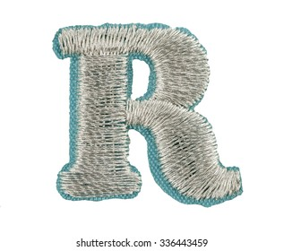 Fonts that are stitched with thread isolated on white capitol letter R