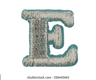 Fonts that are stitched with thread isolated on white capitol letter E