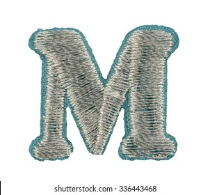 Fonts that are stitched with thread isolated on white capitol letter M