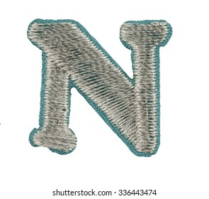Fonts that are stitched with thread isolated on white capitol letter N