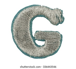 Fonts that are stitched with thread isolated on white capitol letter G