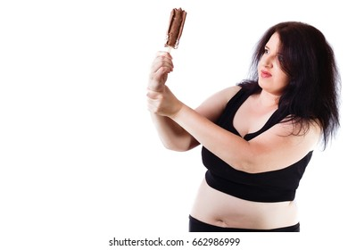 Food addiction, diet, overweight, healthcare, weight loosing, fitness, well-being concept. Young overweight food addicted woman struggling with herself, keeping from eating ice cream
