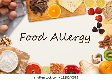 Food allergy collage. Set of allergic products, cheese, honey, citrus fruits, eggs, chocolate, berries and seafood on wooden boards, isolated on white with black inscription, top view