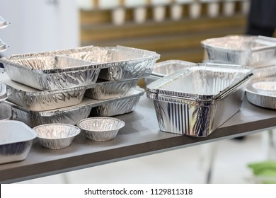 A lot of food aluminum containers. Metal forms for storing food. Forms for baking.