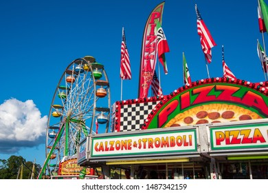 Food and amusement park rides at a country fair.