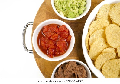 Food Appetizers Chips and Salsa Refried Beans Guacamole on Wood Cutting Board