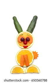 Food art creative concepts. Cute bunny rabbit made of fruits and vegetables, such as orange, cucumber and carrots isolated on a white background