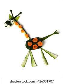 Food art creative concepts. Funny and cute giraffe made of cucumber and carrots isolated on a white background.