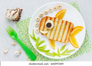 Food art idea - grilled sandwich shaped fish for funny kids breakfast