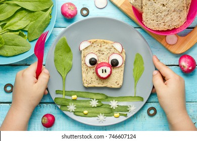 Food art for kids funny sandwich shaped pig from bread and vegetables
