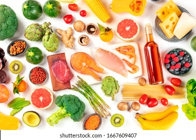 Food assortment, a flat lay of various products, with meat, fish, chicken and shrimps, vegetables and fruits, wine and cheese, shot from above on a white background