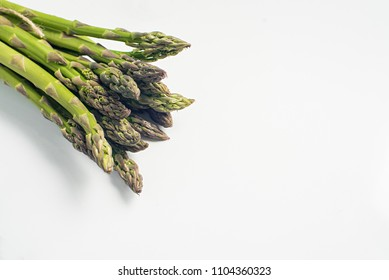 Food background asparagus flat lay pattern. fresh green asparagus on white background, top view.