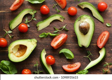 food background avocado, tomato and fragrant herbs