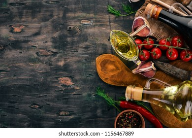 Food Background. Cherry tomatoes, spices and sauces. Top view. On a wooden background. Free space for text.