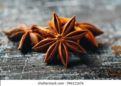 Food Background with Close-up of Star Anise on Vintage Black Table. Selective Focus.