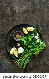 food background of culinary ingredients with blank space for a text on a dark metal table top